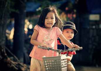 children riding bicycle